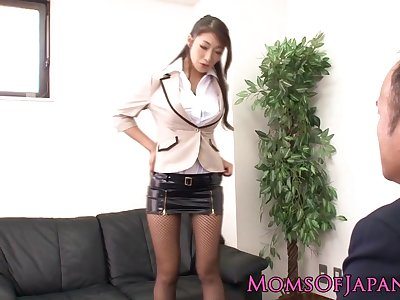 Japanese milf in stockings rammed at the workplace