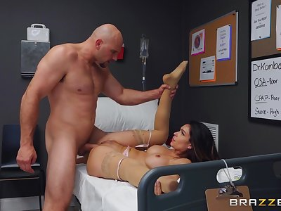 Muscular man fucks the nurse on the top of the hospital bed