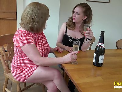 Two horny mature lesbians slowly stripping and playing with their jumbo boobs