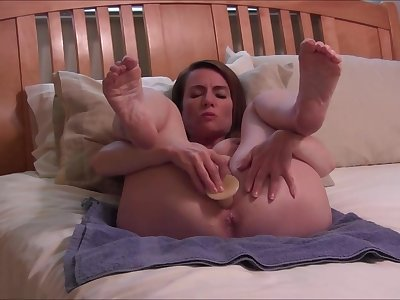 Bald MILF near big tits and lovely feet toying herself up bed