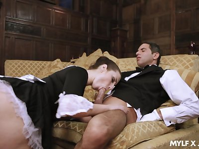 Naughty maid Paige Turnah gives a blowjob to sweltering butler